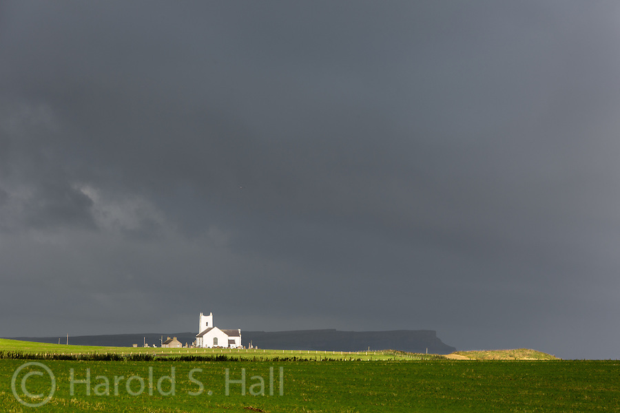 The church in Ballintoy is bathed in a brief bit of sunshine on this cloudy morning.