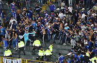 BOGOTA -COLOMBIA, 6-08-2017.Hinchas de Millonarios se enfrentaron con la policía en la tribuna sur durante el encuentro entre Millonarios y Atletico Junior por la fecha 6 de la Liga Aguila II 2017 jugado en el estadio Nemesio Camacho El Campin de la ciudad de Bogota. / Fans of Millonarios fight with the police in the south tribune during match between Millonarios and Atletico Junior for the date 6 of the Liga Aguila II 2017 played at the Nemesio Camacho El Campin Stadium in Bogota city. Photo:VizzorImage / Felipe Caicedo  / Staff