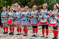Matang, a Gejia Village in Guizhou, China.  Women Holding Bowls of Rice Wine, Singing to Welcome Visitors to the Village.
