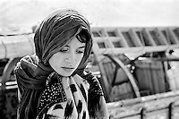 Afghan refugees arrive at a United Nations High Commissioner for Refugees processing site after returning from Pakistan with all their belongings on lorries through the notoriously dangerous Khyber pass on July 7 2002. More than six million people fled Afghanistan during the years of conflict following the Soviet invasion in 1979.
