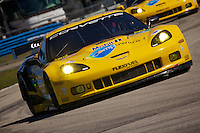 The #04 Corvette of Oliver Gavin, Jan Magnussen and Richard Westbrook races through a turn during qualifying for the 12 Hours of Sebring, Sebring International Raceway, Sebring, FL, March 18, 2011.  (Photo by Brian Cleary/www.bcpix.com)