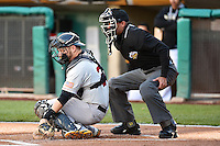 Stephen Vogt (26) of the Sacramento River Cats behind the plate with home plate umpire Roberto Ortiz during the game against the Salt Lake Bees at Smith's Ballpark on April 5, 2014 in Salt Lake City, Utah.  (Stephen Smith/Four Seam Images)