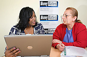Money Matters Adviser Thalia gives advice to client Samira.  Advice sessions take place at the Beethoven Centre in Queen's Park and at the Greenside Community Centre, in Church Street ward.