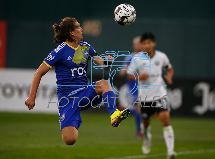 Reno 1868 FC's Emilio Ycaza competes against Tacoma Defiance FC in Reno, Nev., on Sept. 17, 2020. Reno locks in a playoff spot with their 3-2 victory.  <br />Photo by Cathleen Allison