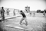An Afghan National Army soldier tees off at Masum Ghar, in Panjwayi district, Kandahar, 27 April 2013, as US troops from Bayonet Company, 1-38 Infantry prepare to leave.  (John D McHugh)