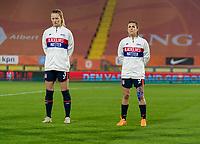 BREDA, NETHERLANDS - NOVEMBER 27: Samantha Mewis #3 and Kelley O'Hara #5 of the USWNT line up during the national anthem before a game between Netherlands and USWNT at Rat Verlegh Stadion on November 27, 2020 in Breda, Netherlands.