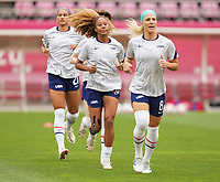 KASHIMA, JAPAN - AUGUST 2: Julie Ertz #8 of the United States warms up during a game between Canada and USWNT at Kashima Soccer Stadium on August 2, 2021 in Kashima, Japan.