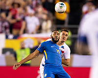 PHILADELPHIA, PA - JUNE 30: Jafar Arias #19 and Aaron Long #23 vie for a header during a game between Curaçao and USMNT at Lincoln Financial Field on June 30, 2019 in Philadelphia, Pennsylvania.