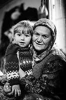 A Bosnian mother and child at the Varazdin refugee camp in the winter of 1992. <br /> <br /> In 1992 while volunteering at the Varazdin refugee camp Panos photographer Bjoern Steinz met and became close to Elvis, a Bosnian Muslim refugee, and his family. They shared the hardships of camp life together which Steinz documented. While the prints were archived for many years two of the images always returned to Bjoern's thoughts. 25 years later he set out to try and find out what had happened to Elvis and his family in the intervening years. Modern social media made the task surprisingly easy and they were reunited in Hadzici where Elvis now lives with his family.