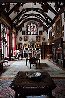 The lofty dining room with its hammerbeam ceiling is part the older 16th century house and was the former entrance hall