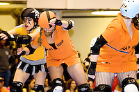 The Bronx Gridlock and the Manhattan Mayhem clash at a Gotham Girls Roller Derby bout in New York City on May 6, 2006.