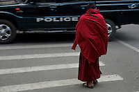 Monk crossing the road street life in the town of Thimphu, Bhutan