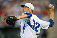 Florida Gators pitcher Logan Shore (32) warms up during a long break against the Miami Hurricanes in the NCAA College World Series on June 13, 2015 at TD Ameritrade Park in Omaha, Nebraska. Florida defeated Miami 15-3. (Andrew Woolley/Four Seam Images)