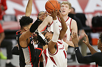 Arkansas guard Jalen Tate (11) rebounds, Saturday, January 9, 2021 during the first half of a basketball game at Bud Walton Arena in Fayetteville. Check out nwaonline.com/210110Daily/ for today's photo gallery. <br /> (NWA Democrat-Gazette/Charlie Kaijo)