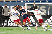 FOXBOROUGH, MA - OCTOBER 16: Colby Quinones #41 of New England Revolution II attempts to bring the ball forward as Benjamin Redzic #37 of North Texas SC and Arturo Rodriguez #10 of North Texas SC come in to tackle during a game between North Texas SC and New England Revolution II at Gillette Stadium on October 16, 2020 in Foxborough, Massachusetts.