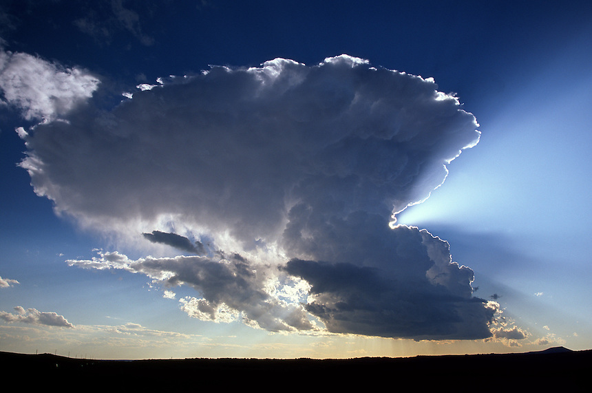 A cumulonimbus cloud (thunderstorm) develops rapidly over the highlands of northeastern New Mexico in June. These storms often produce copious amounts of large hail.