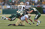 Wofford Terriers running back Ray Smith (22), Baylor Bears defensive back Sam Holl (25) and Baylor Bears linebacker Bryce Hager (44)  in action during the game between the Wofford Terriers and the Baylor Bears at the Floyd Casey Stadium in Waco, Texas. Baylor leads Woffard 38 to 0 at halftime.