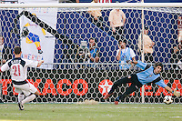 Panama's goalkeeper Jaime Penedo is unable to stop the shot of USA's Brad Davis during the shootout. The United States defeated Panama in a shoot out after a scoreless game to win the CONCACAF Gold Cup at Giant's Stadium, East Rutherford, NJ, on July 24, 2005.