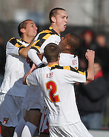 Casey Townsend #11 of the University of Maryland is congratulated by teammates after scoring the first goal during an NCAA quarter-final match against the University of Michigan at Ludwig Field, University of Maryland, College Park, Maryland on December 4 2010.Michigan won 3-2 AET.