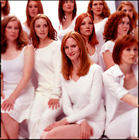 Group of red haired women wearing white clothes