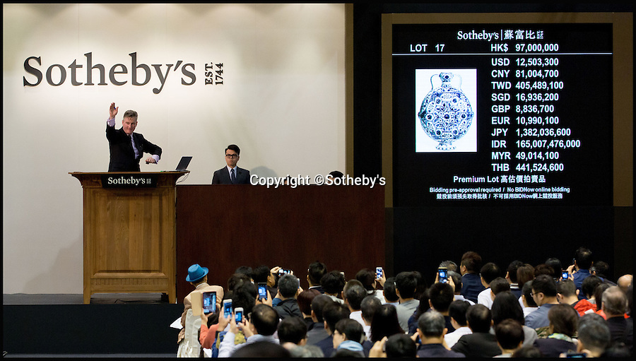 BNPS.co.uk (01202 558833)<br /> Pic: Sothebys/BNPS<br /> <br /> Hammer comes down on the £10.1 million Moonflask.<br /> <br /> A collection of Chinese antiques that a farmer paid as little as £100 per item for has sold for a whopping £45.9 million.<br /> <br /> The late Roger Pilkington accumulated about 100 pieces of exquisite Chinese ceramics in the late 1950s and early '60s <br /> <br /> He died in 1969 aged just 40. His 'time capsule' collection has remained in his family ever since and they have now sold it at auction.<br /> <br /> Leading the sale was a 9ins tall 15th century blue and white Moon Flask which sold for a £10.1m.