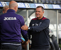 Pictured L-R: Swansea coach Cameron Toshack greets West Ham United coach Terry Westley Friday 26 August 2016<br />Re: Swansea City FC v West Ham United, Division 2, Premier League 2, at the Liberty Stadium, Swansea, Wales, UK