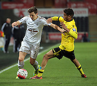 Pictured: Aaron Lewis of Swansea (L) tries to get past an Aston Villa player Monday 25 April 2016<br /> Re: Play Off semi final, Swansea City AFC U21 v Aston Villa FC U21 at the Liberty Stadium, Swansea, UK