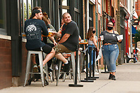 Patrons dine outside of Industry Public House in the Lawrenceville neighborhood on Tuesday July 21, 2020 in Pittsburgh, Pennsylvania. (Photo by Jared Wickerham/Pittsburgh City Paper)