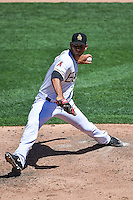 Salt Lake Bees relief pitcher Edgar Ibarra (23) delivers a pitch to the plate against the El Paso Chihuahuas in Pacific Coast League action at Smith's Ballpark on July 26, 2015 in Salt Lake City, Utah. El Paso defeated Salt Lake 6-3 in 10 innings. (Stephen Smith/Four Seam Images)