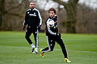 Thursday 20 March 2014<br /> Pictured:( L-R )  Chico Flores and Jose Canas<br /> Re: Swansea City Training at their Fairwood training facility, Swansea, Wales,UK