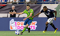 Foxborough, Massachusetts - July 7, 2018: In a Major League Soccer (MLS) match, New England Revolution (blue/white) tied Seattle Sounders FC (green/blue), 0-0, at Gillette Stadium.