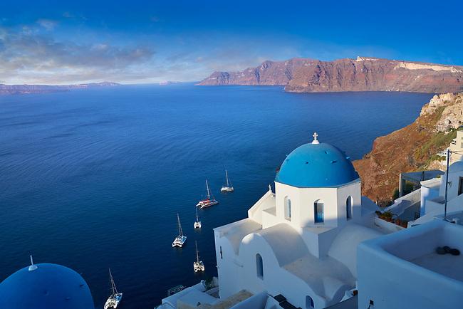 Traditional blue domed Greek Orthodox church of Oia, Santorini ( Thira ) Island, Greece.