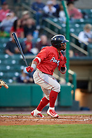 Pawtucket Red Sox right fielder Aneury Tavarez (20) follows through on a swing during a game against the Rochester Red Wings on May 19, 2018 at Frontier Field in Rochester, New York.  Rochester defeated Pawtucket 2-1.  (Mike Janes/Four Seam Images)