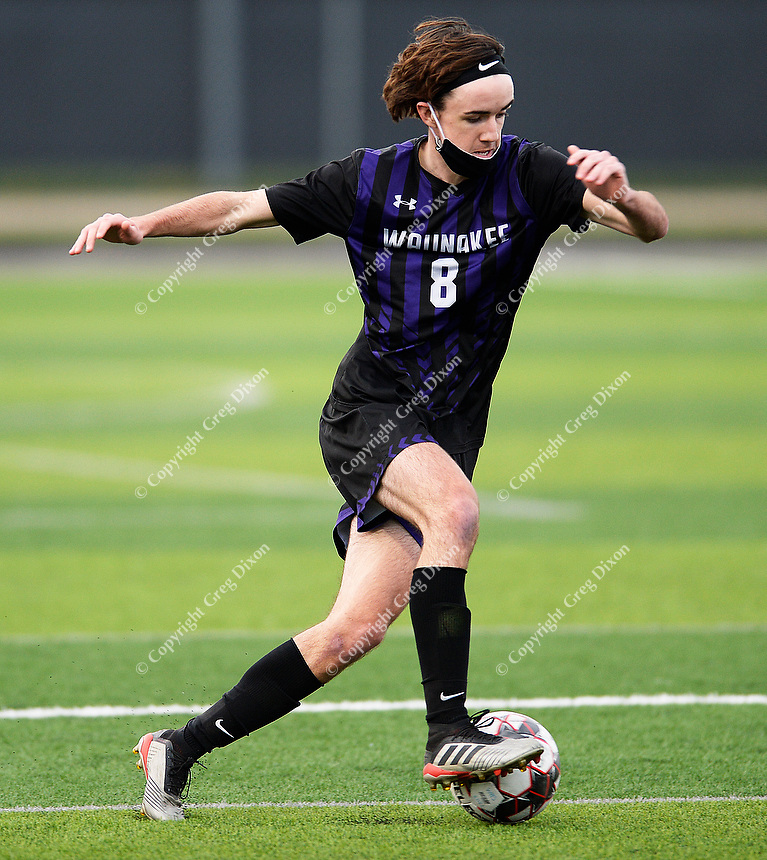 Waunakee's Mason Lee brings the ball up the pitch, as Oregon takes on Waunakee in Wisconsin WIAA Badger Conference boys high school soccer on Tuesday, Apr. 27, 2021 at Waunakee High School