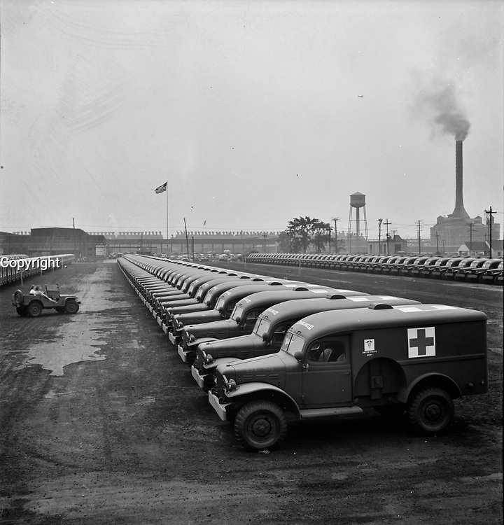 Chrysler Corporation Dodge truck plant. Dodge Army ambulances are here, lined up for delivery to the Army. Detroit, Michigan, August 1942.<br /> <br /> Photo by Arthur S. Siegel.