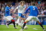 Rangers v St Johnstone....27.02.11 .Stevie May is blocked by Sasa Papac and Maurice Edu.Picture by Graeme Hart..Copyright Perthshire Picture Agency.Tel: 01738 623350  Mobile: 07990 594431