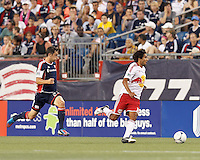 New York Red Bulls midfielder Mehdi Ballouchy (10) dribbles. In a Major League Soccer (MLS) match, New England Revolution defeated New York Red Bulls, 2-0, at Gillette Stadium on July 8, 2012.