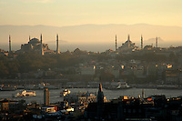 The Hagia Sophia and Blue Mosques at sunset with the Golden Horn in the foreground and the Sea of Marmara behind, Istanbul, Turkey