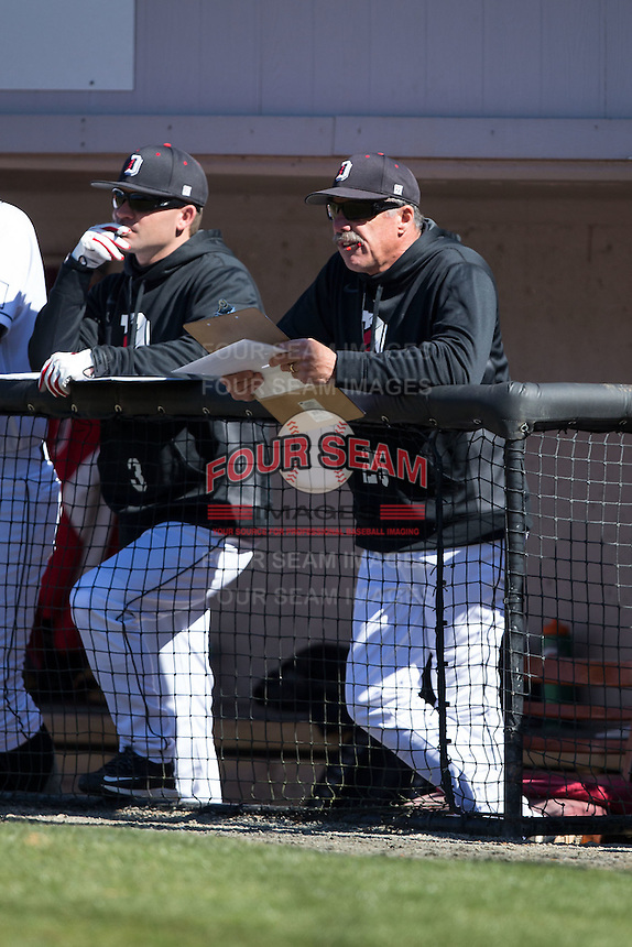 Davidson Wildcats head coach Dick Cooke (25) watches the action from the dugout during the game against the Saint Louis Billikens at Wilson Field on March 28, 2015 in Davidson, North Carolina. (Brian Westerholt/Four Seam Images)