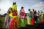 Female Shawl dancers enter the dance arena.
