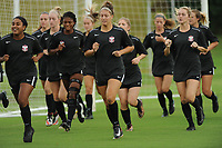 NWA Democrat-Gazette/ANDY SHUPE<br /> Arkansas soccer players run Wednesday, Aug. 16, 2017, while warming up before the start of practice at Razorback Field in Fayetteville. The Razorbacks enter the season ranked 17th and are coming off a year they finished No. 19, made the SEC tournament finals and won a match in the NCAA Tournament.