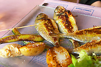 Gruissan village. La Clape. Languedoc. Restaurant La Cranquette. Grilled fried Saucanelles baby-dorade seabream on a skewer. France. Europe.