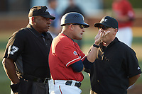 Liberty Flames head coach Scott Jackson (15) argues a call with first base umpire Joseph Holt (right) and home plate umpire Gregory Street (left) during the game against the Wake Forest Demon Deacons at David F. Couch Ballpark on April 25, 2018 in  Winston-Salem, North Carolina.  The Demon Deacons defeated the Flames 8-7.  (Brian Westerholt/Four Seam Images)
