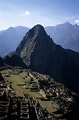 Machu Picchu, Peru. An overview of the ruins in the foreground with the Wayna Picchu peak in the background.