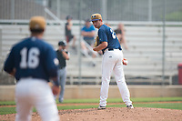 Helena Brewers starting pitcher Justin Bullock (25) checks the runner at first base during a Pioneer League game against the Grand Junction Rockies at Kindrick Legion Field on August 19, 2018 in Helena, Montana. The Grand Junction Rockies defeated the Helena Brewers by a score of 6-1. (Zachary Lucy/Four Seam Images)