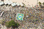 Protesters carry a huge Brazilian flag. Rio de Janeiro, Brazil, 15th March 2015. Popular demonstration against President Dilma Rousseff.