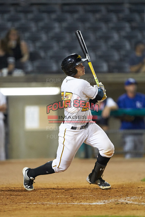 Deon Stafford (22) of the West Virginia Power follows through on his swing against the Lexington Legends at Appalachian Power Park on June 7, 2018 in Charleston, West Virginia. The Power defeated the Legends 5-1. (Brian Westerholt/Four Seam Images)