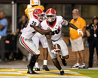 KNOXVILLE, TN - OCTOBER 5: Tae Crowder #30 of the Georgia Bulldogs is congratulated by J.R. Reed #20 of the Georgia Bulldogs after running a fumble recovery for a touchdown during a game between University of Georgia Bulldogs and University of Tennessee Volunteers at Neyland Stadium on October 5, 2019 in Knoxville, Tennessee.