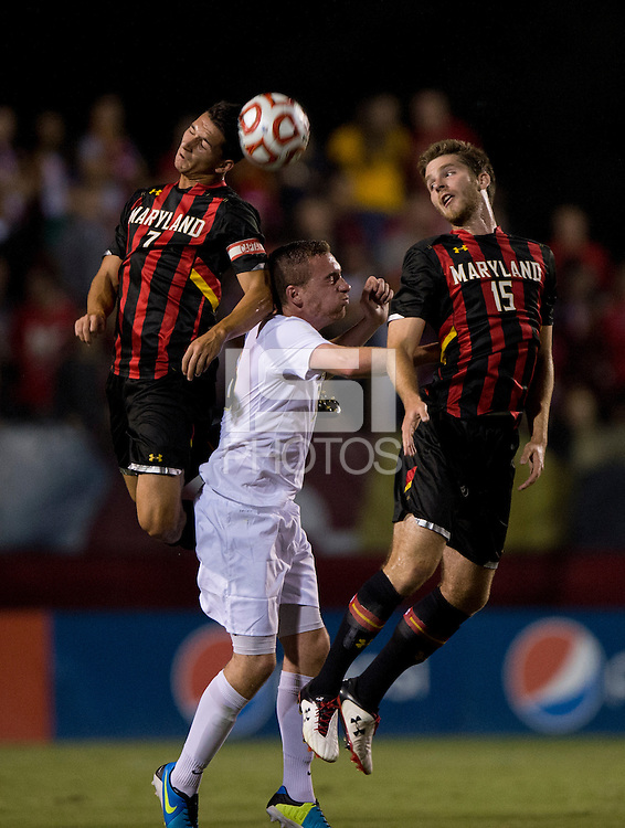 Patrick Mullins (15) and Dan Metzger (7) of Maryland go up for a header against Michael Tuohy (16) of Pittsburgh during the game at Ludwig Field on the campus of the University of Maryland in College Park, MD.  Maryland defeated Pittsburgh, 2-0.