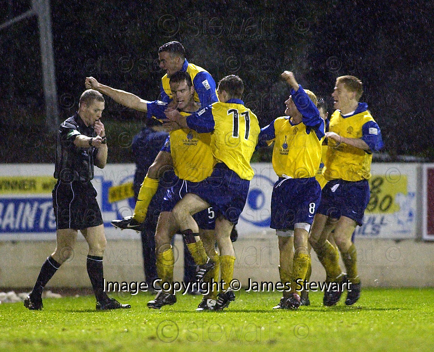 20/12/03          Copyright Pic : James Stewart.File Name : stewart11-stjohn_v_qos.BRIAN REID IS CONGRATULATED AFTER SCORING QOTS'S SECOND..... .Payment should be made to :-.James Stewart Photo Agency, 19 Carronlea Drive, Falkirk. FK2 8DN      Vat Reg No. 607 6932 25.Office     : +44 (0)1324 570906     .Mobile  : +44 (0)7721 416997.Fax         :  +44 (0)1324 570906.E-mail  :  jim@jspa.co.uk.If you require further information then contact Jim Stewart on any of the numbers above.........